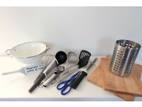 Colander, kitchen utensils, wooden chopping boards, & metal utensil holder
