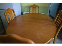 Oval Honey Wood Table with 4 chairs
