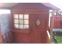 Wooden childrens playhouse. Good condition with furniture,