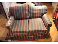 2 matching sofas, some tears on arms, can be used as is or reupholstered