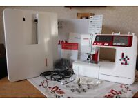 Janome TXL607 Sewing Machine with Quilting Package