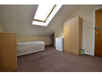A large single room for single person, sharing large kitchen, two bathrooms with three other rooms.