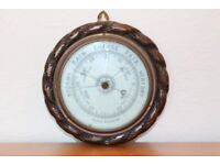 Aneuroid Barometer with wreathed solid wood case