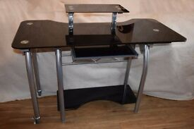 Beautiful black glass and chrome desk/computer workstation. Can be used as a corner unit.