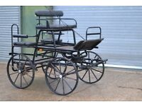 Four wheeled exercise/pleasure/competition vehicle for 14' 2 hh single horse