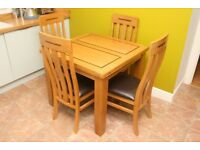 Extending Oak Dining table and 4 chairs, little use in as new condition.
