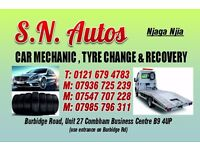 Car mechanic, tire change and car recovery