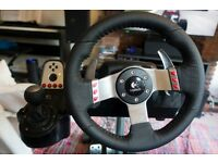 Logitech g27 gaming wheel, with pedals and stand.