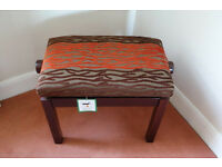 Newly upholstered adjustable piano stool
