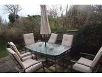 Garden table, six chairs, umbrella and covers