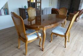 Dining Table, extendable with 2 carver and 2 armless chairs.