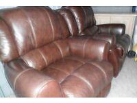 2 BROWN LEATHER RECLINING ARMCHAIRS PLUS 1 LARGE FOOTSTOOL, MUST GO HENCE £60 FOR THE LOT