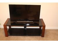 "40"" Sony Bravia TV and tinted glass/cherry wood TV stand"