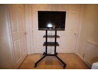 Heavy duty TV stand with wheels, for shop, school, gym, hall, office use, 2 shelves,