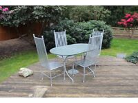 Slate top garden table with silver steel legs and matching steel chairs