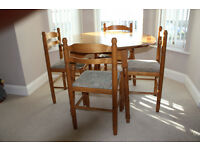 Pine round dining table and 4 chairs - Ideal Kitchen/Dining nice condition.
