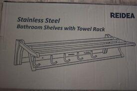 Stainless steel bathroom shelves with towel rack .