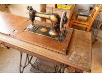 Jones' 3-drawer treadle sewing machine. Original brochure and accessories. Requires new belt.