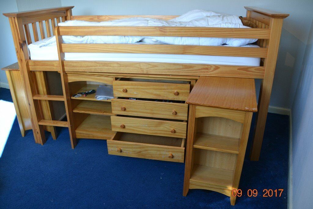 Bunk Bed At One End Cupboard Other Pull Out Desk With Drawers Also