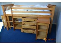 bunk bed /at one end cupboard other end pull out desk with drawers/also four drawers/and three shelf