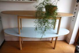 Stylish large oval shaped modern shelf unit.