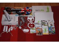 Huge Nintendo Wii Bundle including Wii Fit board, Guitar Hero & other games - £125 ono