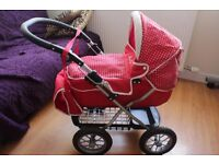 Silver cross dolls red polka dot pram with a bag