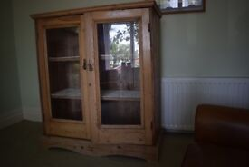 Solid pine glass fronted cabinet. Large chunky piece excellent for storage