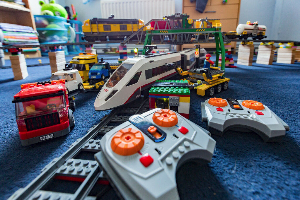 Lego Train Sets plus Automated track switch and extra Tracks. Also ...