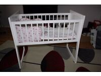 Rocking Crib, mattress, bumber and quilt set and 4 spare sheets
