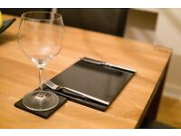 High quality 12 black thick granite placemats + 8 matching coasters. Perfect condition.