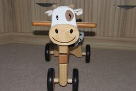 Ride on wooden cow