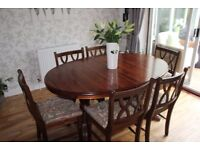 Ducal Dining Table and six chairs in good condition