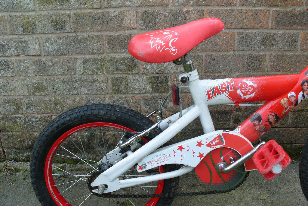Cheap used in gc childs first bike Disney High School brand suit a 4 to 9 year old approx