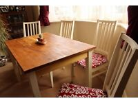 Beautiful rustic re-worked set of dinning table and 4 chairs with dark top and cream chalk chairs