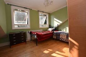 Large sunny room in a two story house moments from Seven Sisters Underground Station