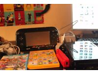 Nintendo Wii U with 11 games + spare controller