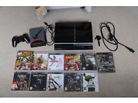 Used PS3 with Assortment of Games and Accessories with working FAKE Controller