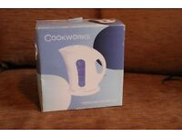 Cook works kettle