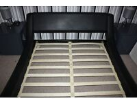 DOUBLE BED £75. Stylish double bed in faux black leather with a modern designer low frame