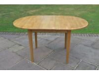 Pine extending oval table