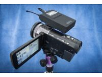Panasonic HC-X900 Camcorder with Wireless Microphone System and Tripod