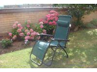 2 practically new garden recliner chairs