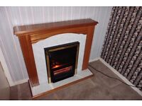 3 bar electric fire complete with surround. Very good new condition.
