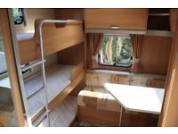 Swift Charisma 565 2010 Fixed Triple Bunk Beds 6 Berth Caravan + Porch Awning