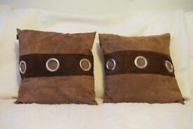 brown cushions faux suede with ring eyelet detail.