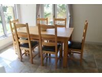Classic oak dining table and 6 chairs made by Riverside Furniture, Tiverton
