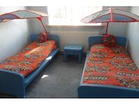 2 blue single beds