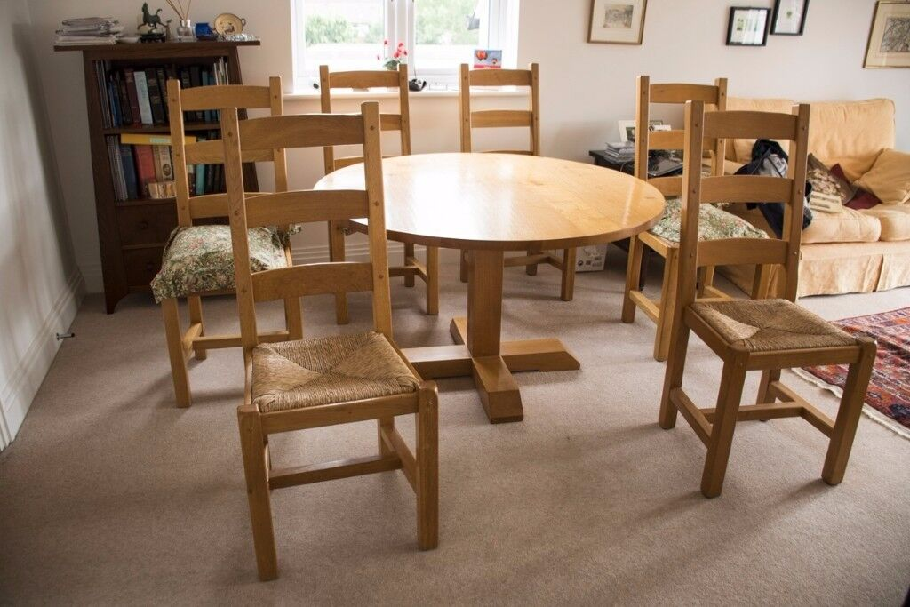 Solid Oak Round Dining Table And Four Matching Chairs For Sale