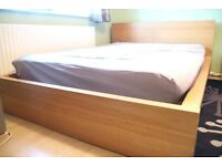 Ikea Double wooden bed (mattress not included)